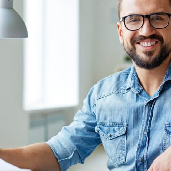 Australia-work-office-guy-in-shirt-smile-happy-1200x565